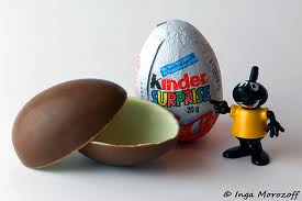 Contrasting chocolate egg with toy